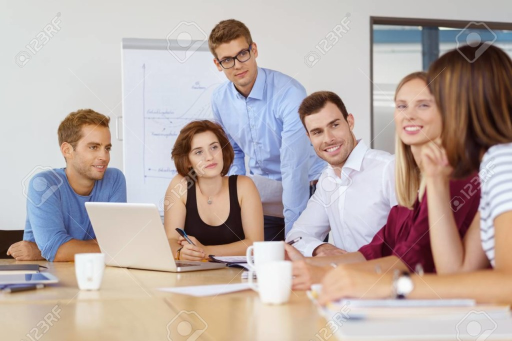 Coworkers listening to each other during meeting